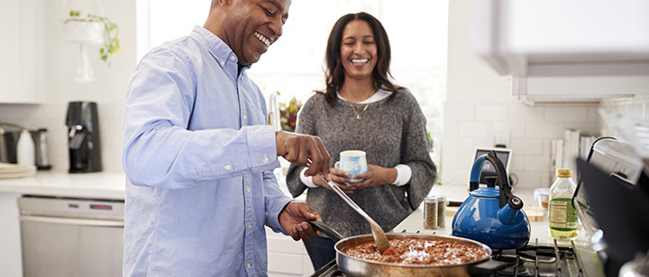 Photo of Couple Cooking with Natural Gas